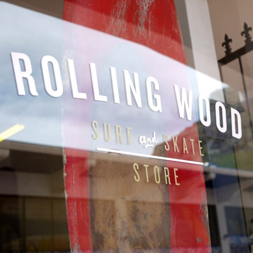 rolling wood surf and skate store logo identity